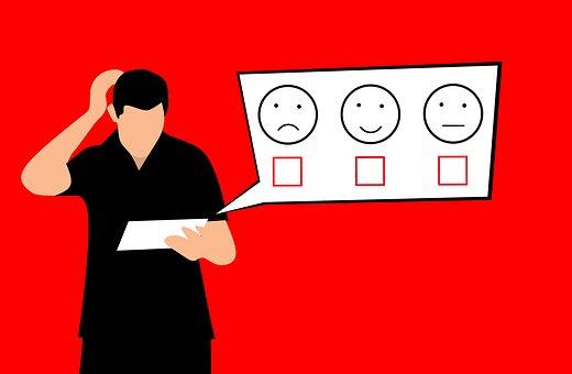 Against a red background, a person with short black and a black shirt and pants scratches their head as they look at a sheet of paper they are holding. A white dialog box shows the viewer what is on the paper. Three emoticons from left to right are frowny, smiley, and neutral. Each face has an empty red checkbox beneath it. Source: http://www.digital-web.com/articles/accountability_of_accessibility_and_usability/