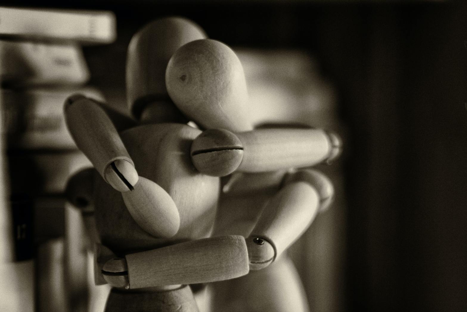 Black and white photo of two wooden art manikins embracing. Source: https://unsplash.com/photos/vzFTmxTl0DQ