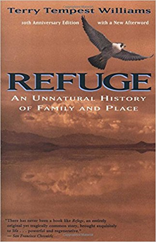 """Book cover for the 10th Anniversary Edition (with a new Afterword) of Terry Tempest Williams' """"Refuge: An Unnatural History of Family and Place."""" Quote at bottom left reads, """"There has never been a book like Refuge, an entirely original yet tragically common story, brought exquisitely to life...powerful and regenerative."""" - San Francisco Chronicle. Cover art depicts a brown bird with white mottled feathers flying above the title, which hovers over a brown-hued lake reflecting distant clouds and hills."""