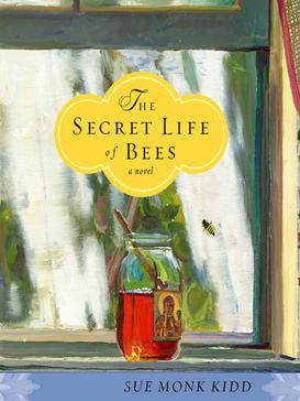 """Book cover. The background is an oil painting of an open glass jar of honey sitting on a bright windowsill, a single bee trying to get at it from the other side of the window. The label on the jar appears to be a holy figure, haloed with golden light and one hand uplifted. In a yellow decorative bubble above the jar is the title: """"The Secret Life of Bees: a novel."""" In a light blue bar across the bottom in black text is the author's name: Sue Monk Kidd."""