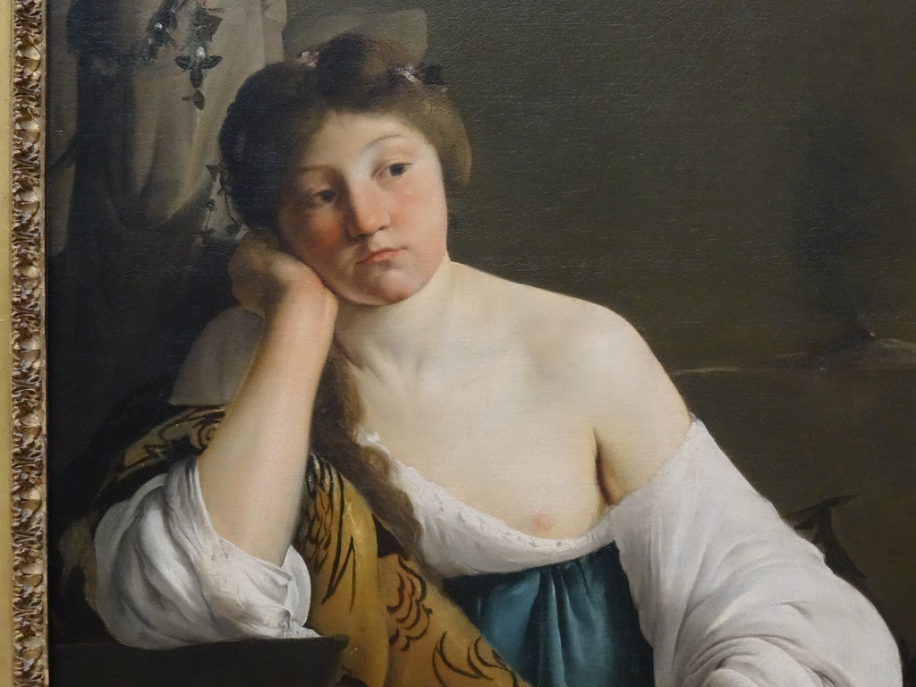 Classical painting: The Disillusioned Medea by Paulus Bor. It depicts a young woman leaning her head on her hand, her elbow propped against a table. She stares distantly, face expressionless.