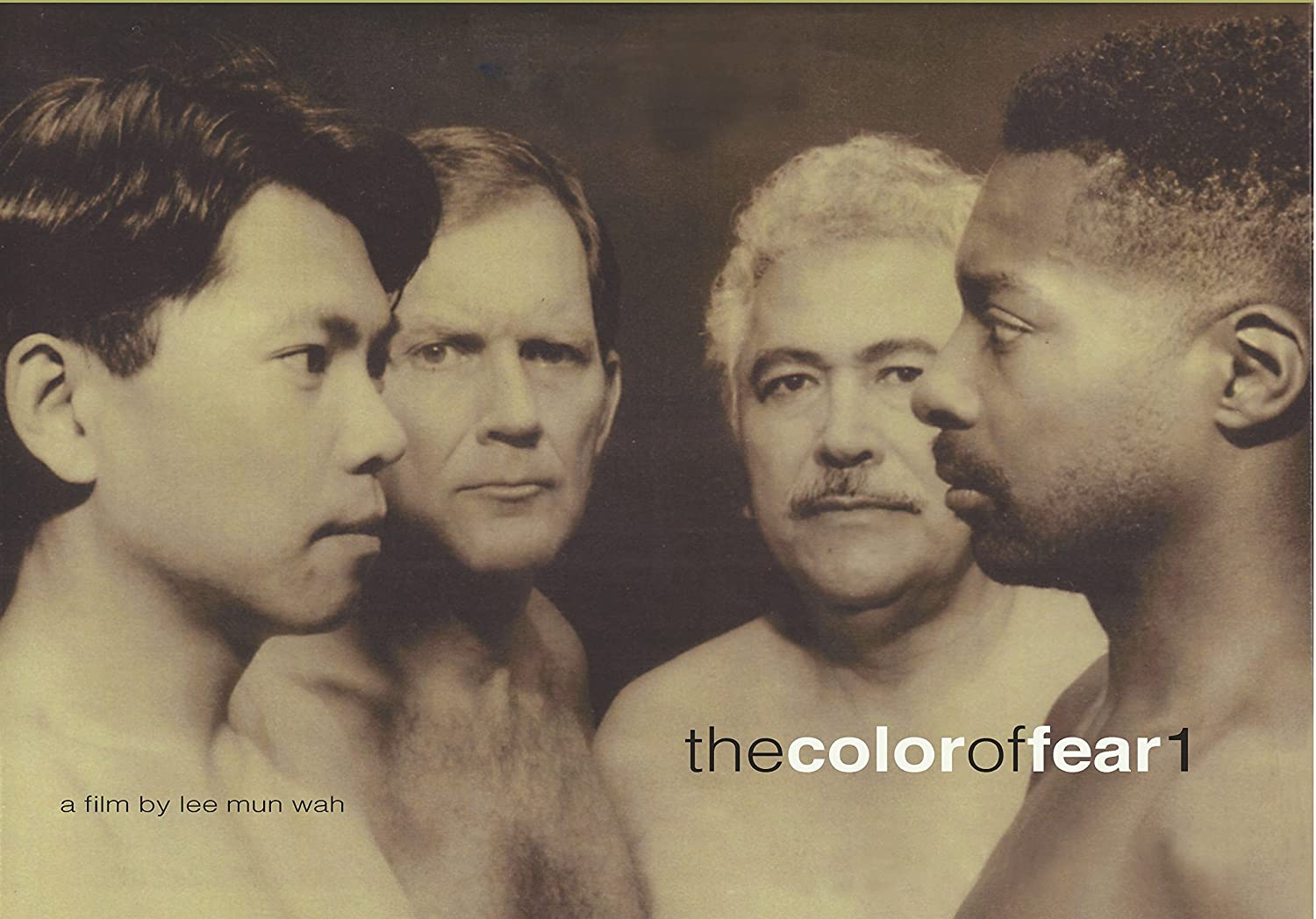 The cover, in black and white, for the film. Four shirtless men are standing closely together. In the foregrounded left is an Asian man facing the Black man on the right, who is looking straight back. Behind them, both looking at the viewer, are a white man (left) and a Latino man (right). Bottom left text: a film by Lee Mun Wah. Bottom right text: The Color of Fear 1.