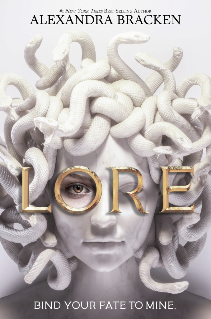 """Book cover for """"Lore"""" by Alexandra Bracken, #1 New York Times Best-Selling Author. A white marble bust of Medusa is centered, snakes coiling and snapping around her calm young face. In uppercase gold letters is the title Lore, and inside the O Medusa's staring eye is made of human flesh. At the bottom is a tagline reading """"Bind your fate to mine."""""""